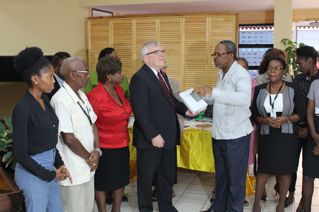 IMPACT Justice donates 244 books to the University of Guyana Library